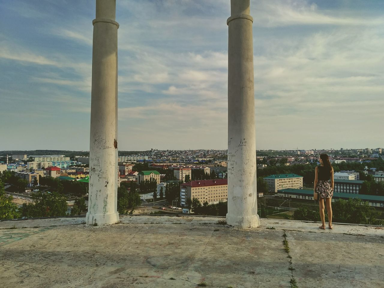 Rear View Full Length Of Woman Standing By Column Against Leninogorsk
