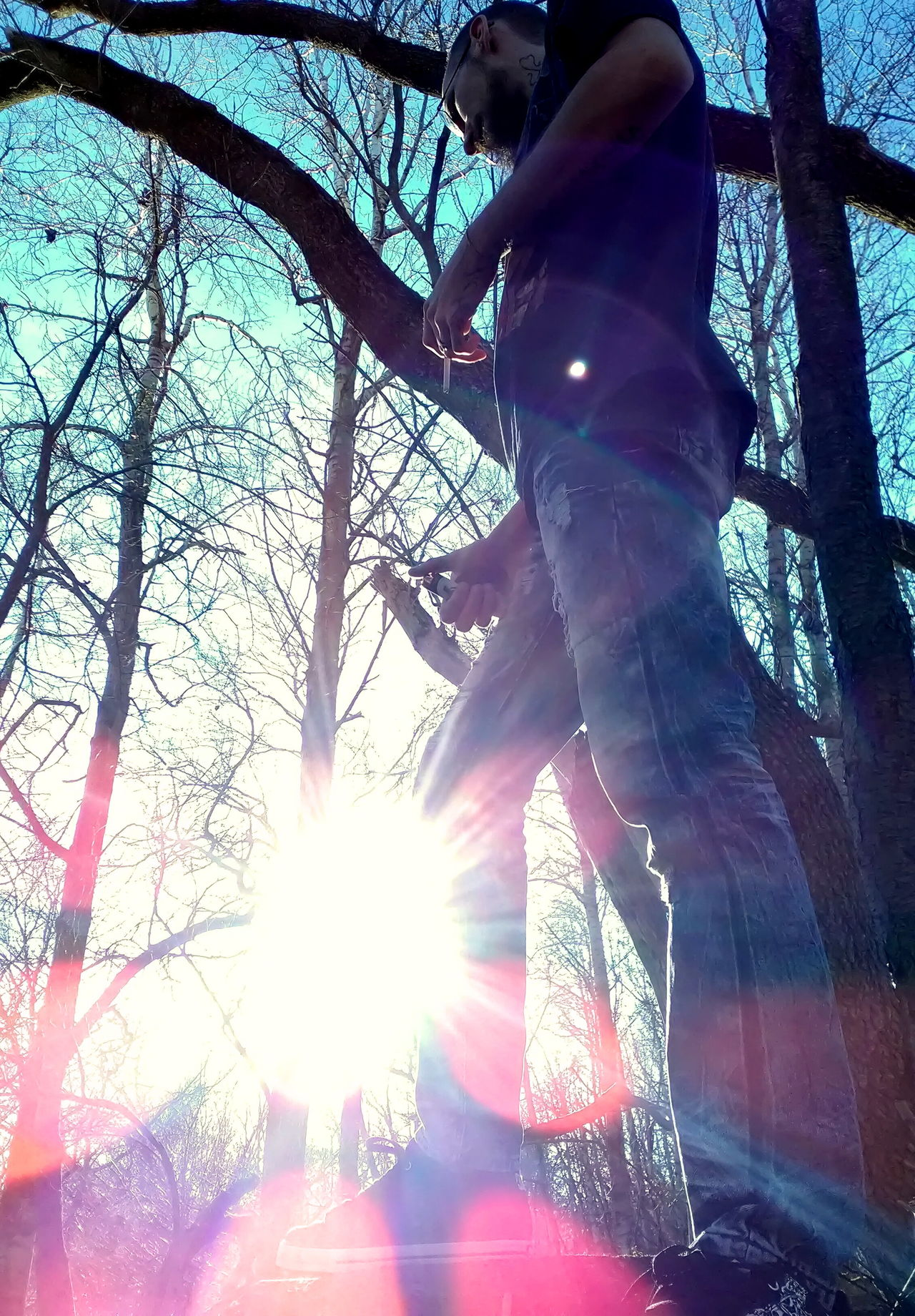 Lens Flare One Person Tree Low Angle View Outdoors Sky Close-up Day Real People, Real Lives My Photography. ❤ Wilderness Area My Husband ❤ 2017 Michigan Outdoors Nature Photography Michigan Up North Nature_perfection My Point Of View Sunbeam Sun Burst Foundation Falling Scenics Weird Finds Old Fountains Broken Building