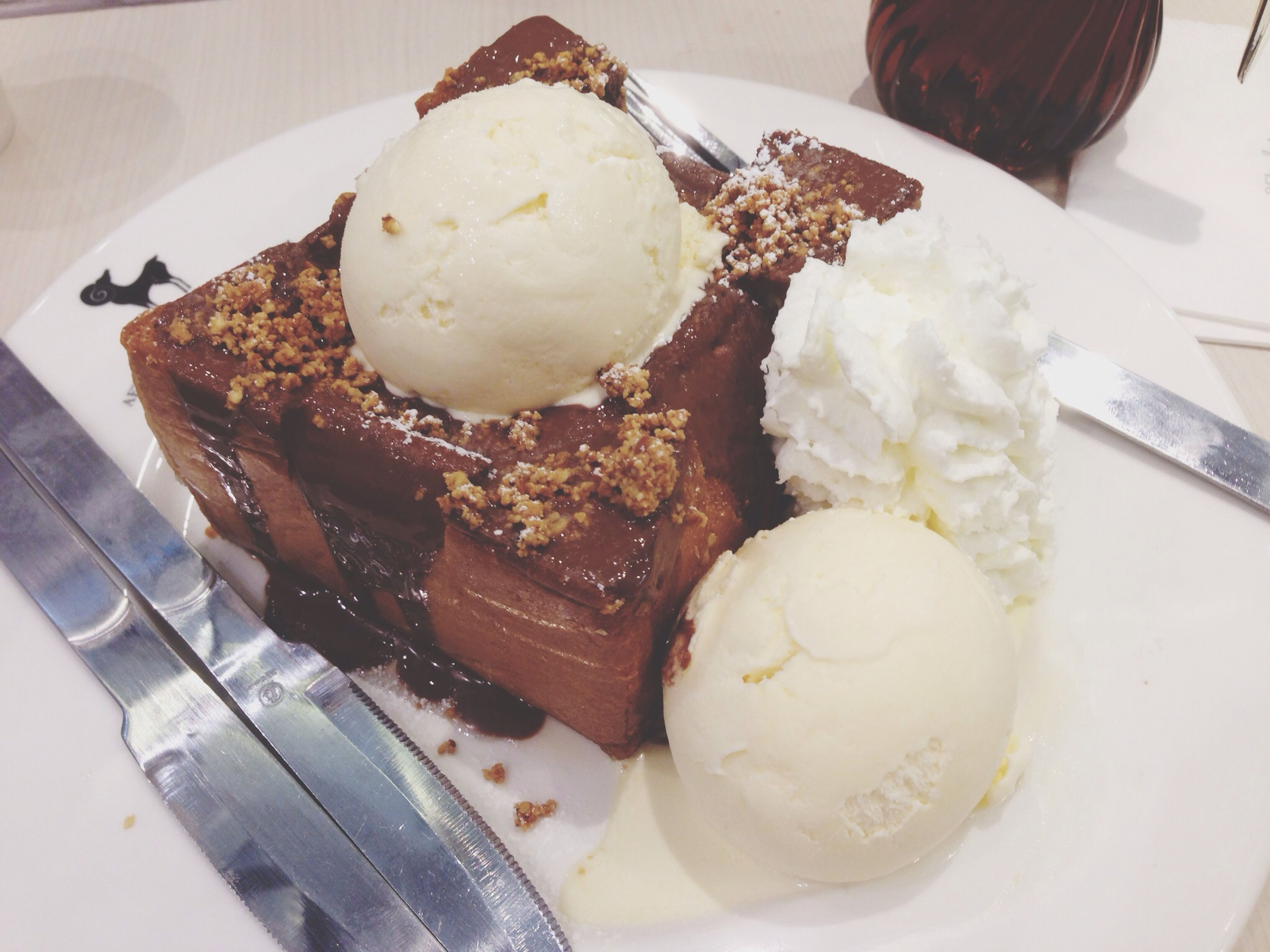 food and drink, food, indoors, freshness, sweet food, ready-to-eat, dessert, indulgence, still life, plate, unhealthy eating, cake, temptation, table, chocolate, high angle view, close-up, serving size, fork, ice cream