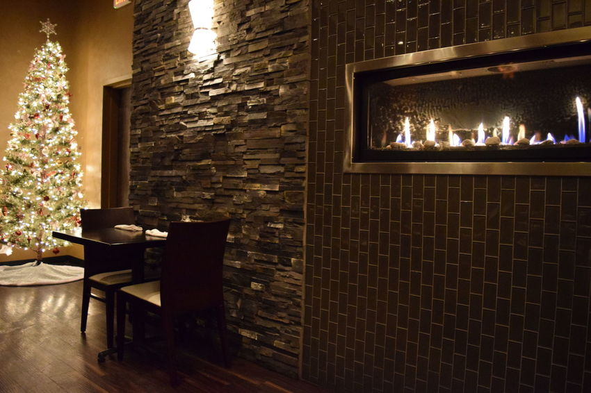 dinner for two-Christmas Absence Architecture Brick Wall Building Built Structure Christmas Christmas Tree Dark Dinner Electric Lamp Fine Dining Fireplace Glowing Illuminated Modern No People Reastaurant Table