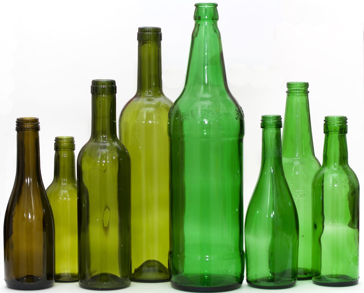 eight green bottles on white background Agriculture Alcohol Bottle Drink Green Bottle Green Color Industry No People Red Wine Wine Wine Bottle Winery