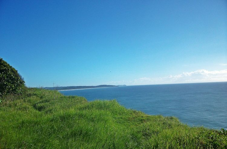 Beach Beauty In Nature Blue Blue Sky Clear Sky Day Grass Horizon Over Water Landscape Nature No People Outdoors Scenics Sea Sky Tranquil Scene Tranquility Water