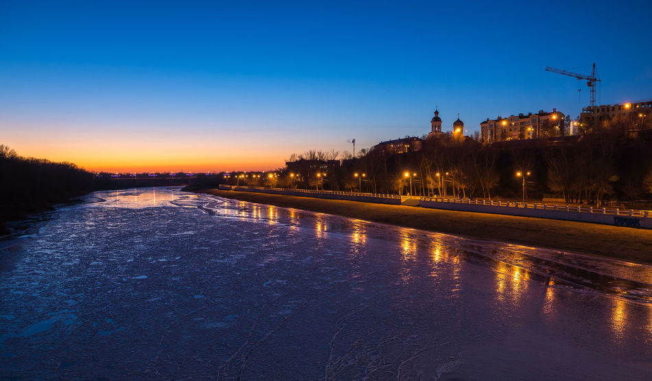 Reflection Water Sunset Tree Sky Outdoors Architecture No People River Ural River Church Cityscape Urban Landscape Multi Colored Evening Architecture Lights And Shadows Illuminated Travel Destinations Ice Winter Reflection Beauty Vibrant Color Evening Sky