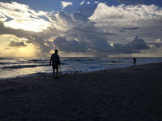 Sunshine & rain treasure hunter Horizon Over Water Melbourne Beach, FL Silhouette Leisure Activity Treasure Hunt  Beach Shore Oceanscape Wave Cloud - Sky Shore Birds Seagulls