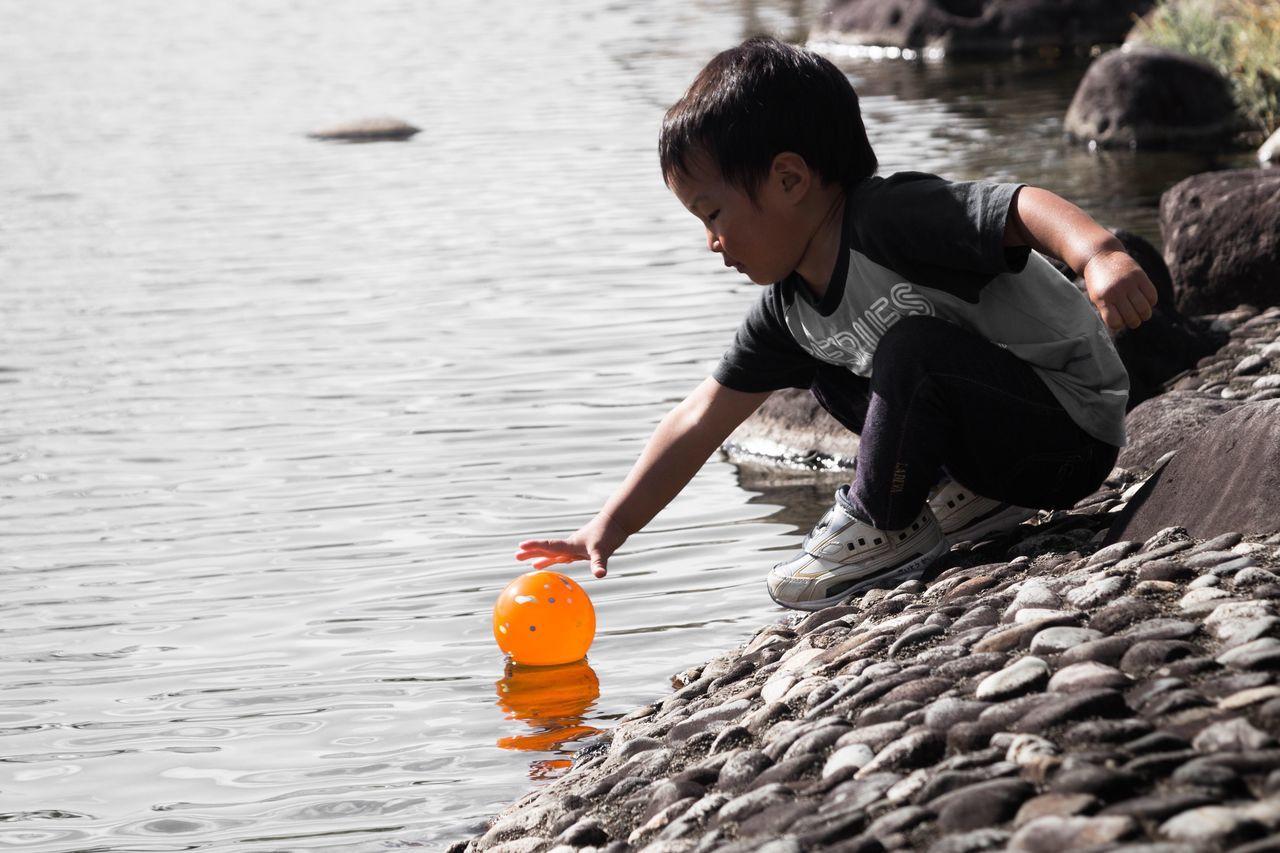 Kids Ball River Children Water Orange Almost Boy Hand
