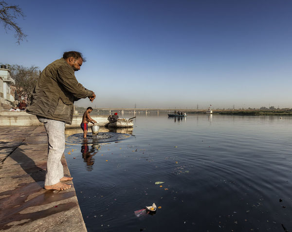 Life at Yamuna : A man doing his daily rituals at yamuna river Culture Daily Life Delicious Documentary Documentary Photography EyeEm EyeEm Best Shots EyeEm Gallery Eyeem Photo EyeEmBestPics Nature Offering Outdoors People People Of India People Photography Ritual River River View Riverbank Riverside Sky The Photojournalist - 2017 EyeEm Awards Water Yamuna
