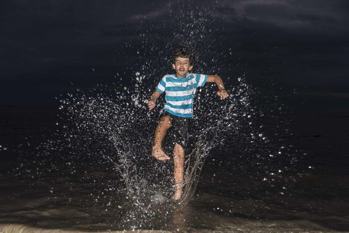 Water flow -my boy Andre kicking the water at the beach at night. Bahia Brazil Nightphotography Porto Seguro Stripes Andre Boys Childhood Motion One Boy Only Refreshment Splashing Water Water Flow Breathing Space Investing In Quality Of Life