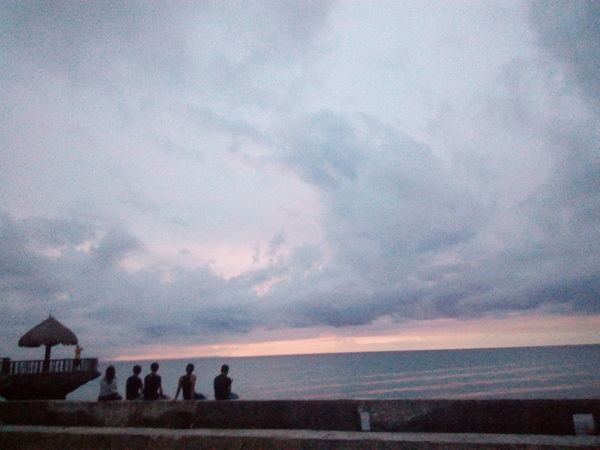 Cloud - Sky Dramatic Sky Water Sunset Sky Sea Outdoors Nature Beauty In Nature Beach Rural Scene Landscape Storm Cloud Summer Agriculture Scenics People Horizon Over Water Adult Building Exterior