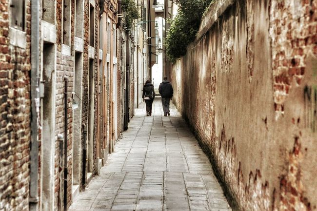 Alley Architecture Built Structure Casual Clothing City City Life Day Diminishing Perspective Footpath Full Length Leisure Activity Lifestyles Narrow Outdoors Rear View Showcase July The Way Forward Vanishing Point Venice, Italy Walkway