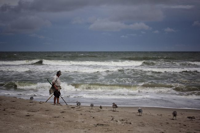 Treasure hunter with an audience Treasure Hunt  Metal Detector Melbourne Beach, FL Horizon Over Water Beach Shore Leisure Activity Lifestyles Surf Seascape Windy Day Cloud - Sky Seagulls Shore Birds Wave Oceanscape