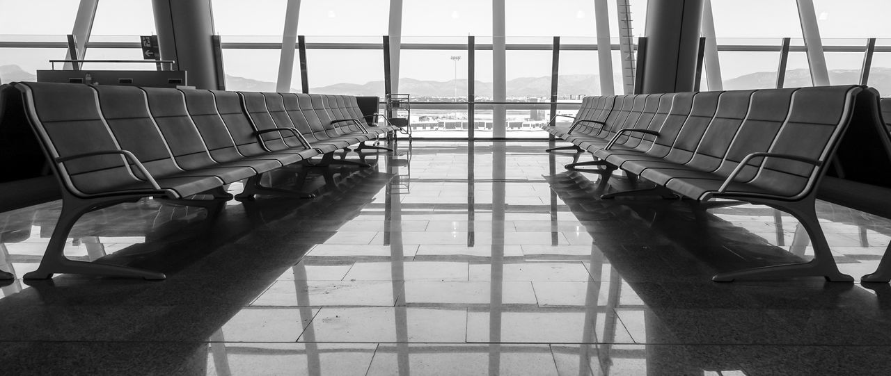 Empty Chairs At Airport Waiting Room