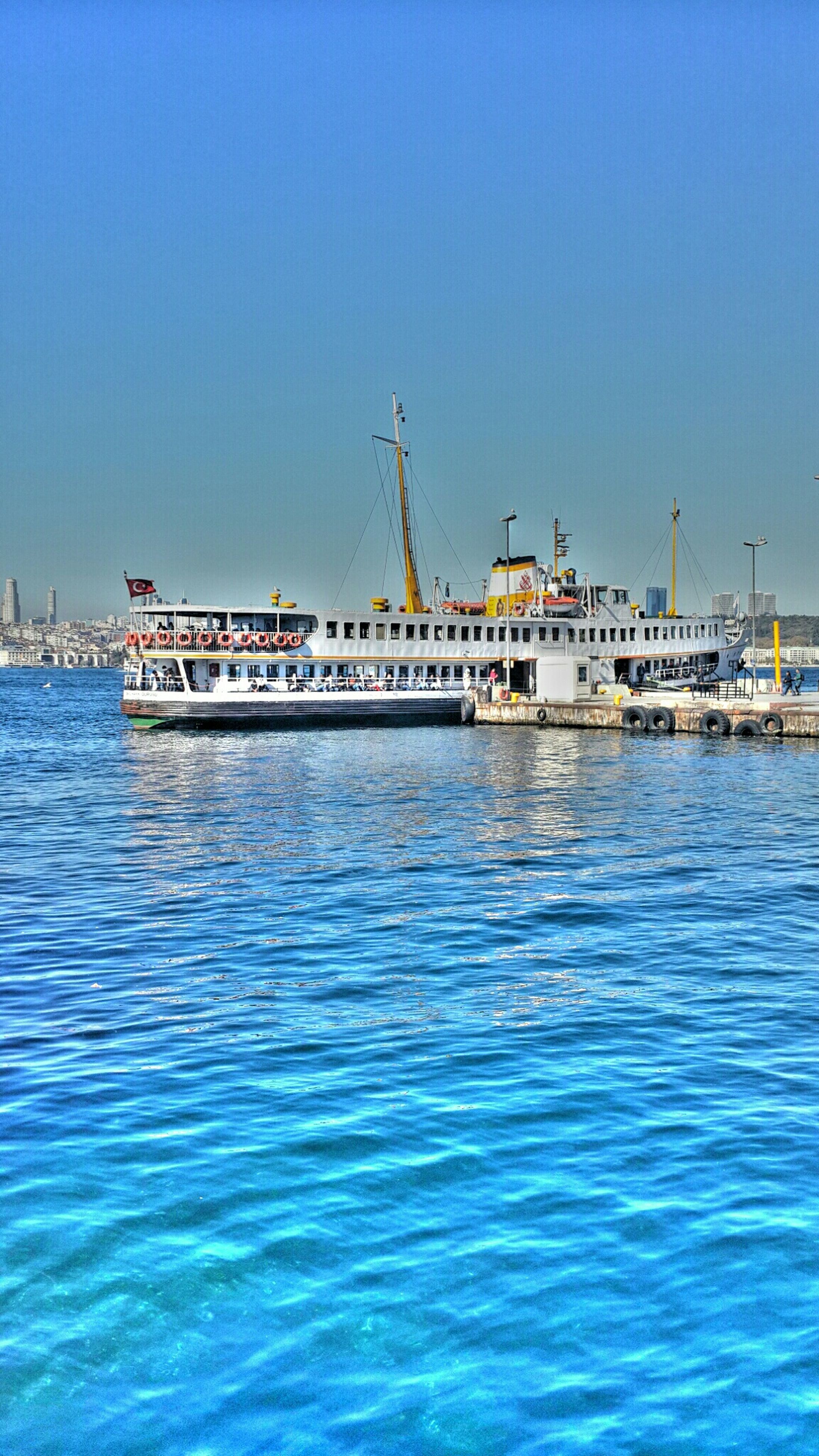 water, clear sky, waterfront, nautical vessel, blue, sea, copy space, transportation, boat, mode of transport, built structure, rippled, moored, nature, architecture, pier, tranquil scene, tranquility, harbor, building exterior
