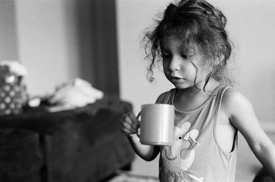 """""""Coffee"""" before talkee Indoors  Long Hair 35mm Film Taking Photos Family Time Snapshots Of Life Love Black And White Collection  People Of EyeEm Film Is Not Dead Eye4photography  Black And White Photography Film Photography Family Getting Inspired Black And White Playing Black And White Portrait Child Filmcamera Filmphotography Filmphoto Black And White Collection  Illfordhp5"""