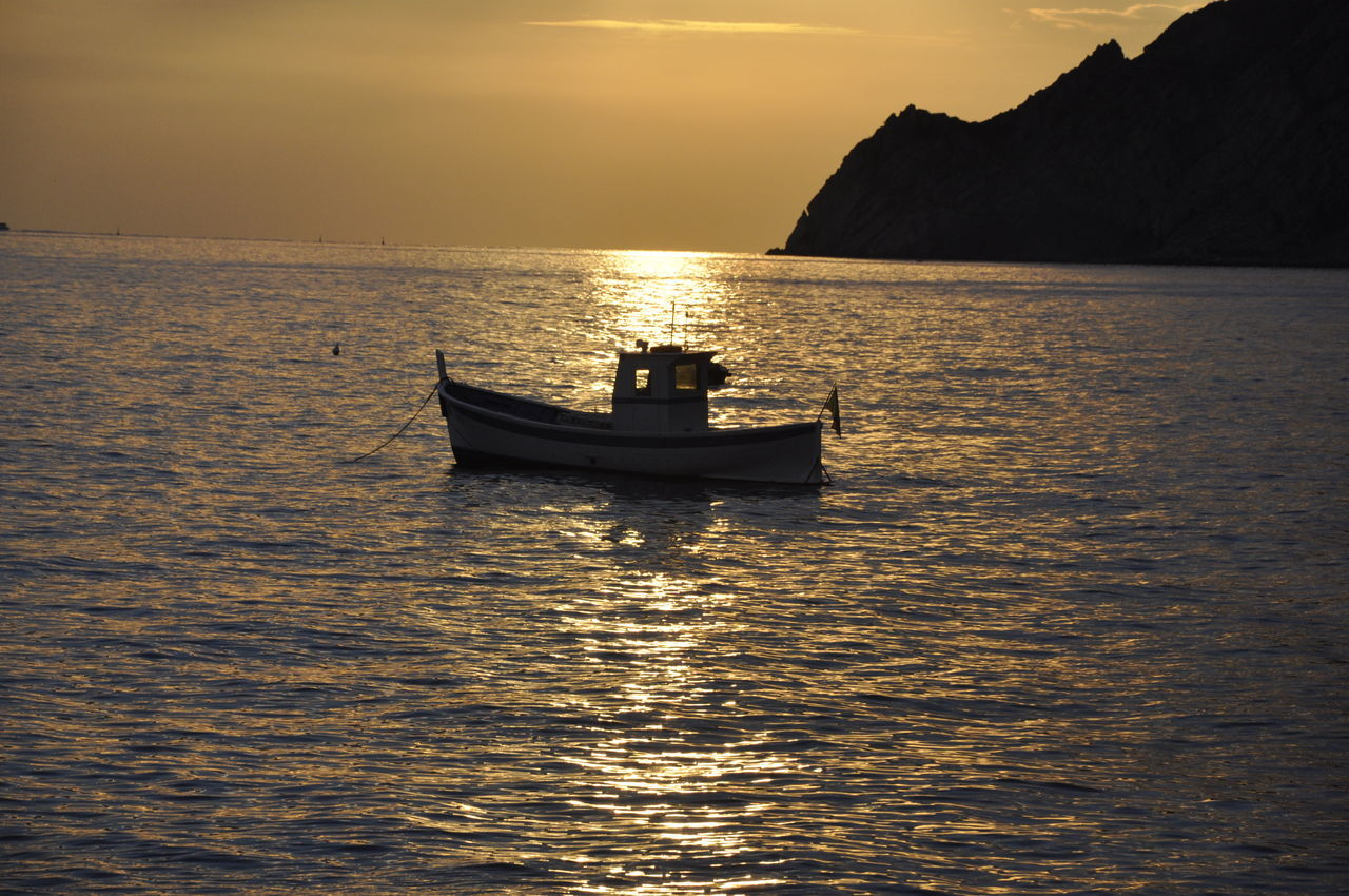 Beauty In Nature Boat Nature Nautical Vessel No People Outdoors Sea Sky Sunset Travel Destinations Water Loneliness Lonely Object Calm Sea