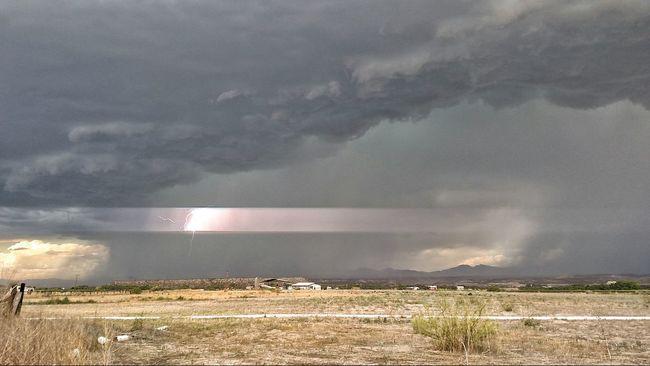 This photo is fantastic. The lightening literally split the sky. Summer Rainstorm Monsoonseason Lighteningstrike Landscapes