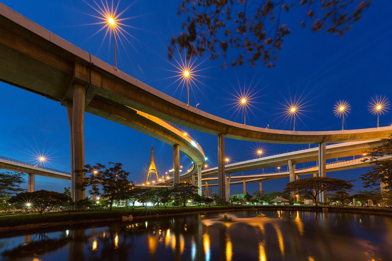 Architectural Column Architecture Bangkok Blue Bridge Bridge - Man Made Structure Built Structure Connection Engineering Illuminated Low Angle View No People Outdoors Reflection Sky Suspension Bridge Tranquility Travel Destinations Water Long Exposure Night Blue Sky