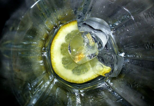 Ice Cubes Slice Of Lemon Bottom Of The Glass Summer Open Edit Single Light Source Up Close EyeEm Best Shots Surfaces And Textures Taking Photos Feeling Creative Open Edits Light And Shadow Cold Drinks