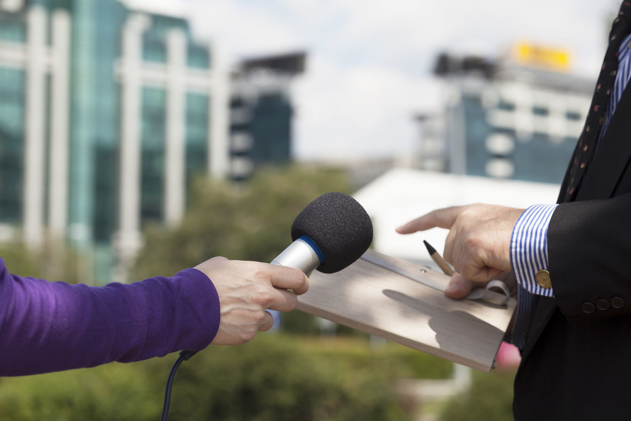Journalist making media interview with businessman Adult Audi Business Businessman BusinessManagementClass City Close-up Communication Corporate Business Day Human Arm Human Body Part Human Hand Interview Men Microphone Microphones Notes From The Underground Outdoors People Spokesman Teamwork Two People Women