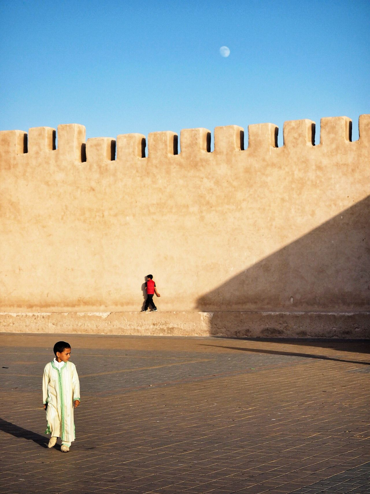 Catch me if you can // Essaouira (Morocco) Two People Real People Clear Sky Full Length Architecture Built Structure Boys Day Leisure Activity Men Sand Lifestyles Standing Outdoors Togetherness Adventure Sky Nature Adult People Streetphotography Morocco Essaouira The Photojournalist - 2017 EyeEm Awards