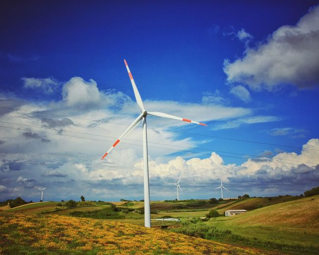 Alternative Energy Beauty In Nature Cloud - Sky Day Environmental Conservation Fuel And Power Generation Industrial Windmill Landscape Low Angle View Nature No People Outdoors Renewable Energy Rural Scene Scenics Sky Tranquil Scene Tranquility Wind Power Wind Turbine Windmill
