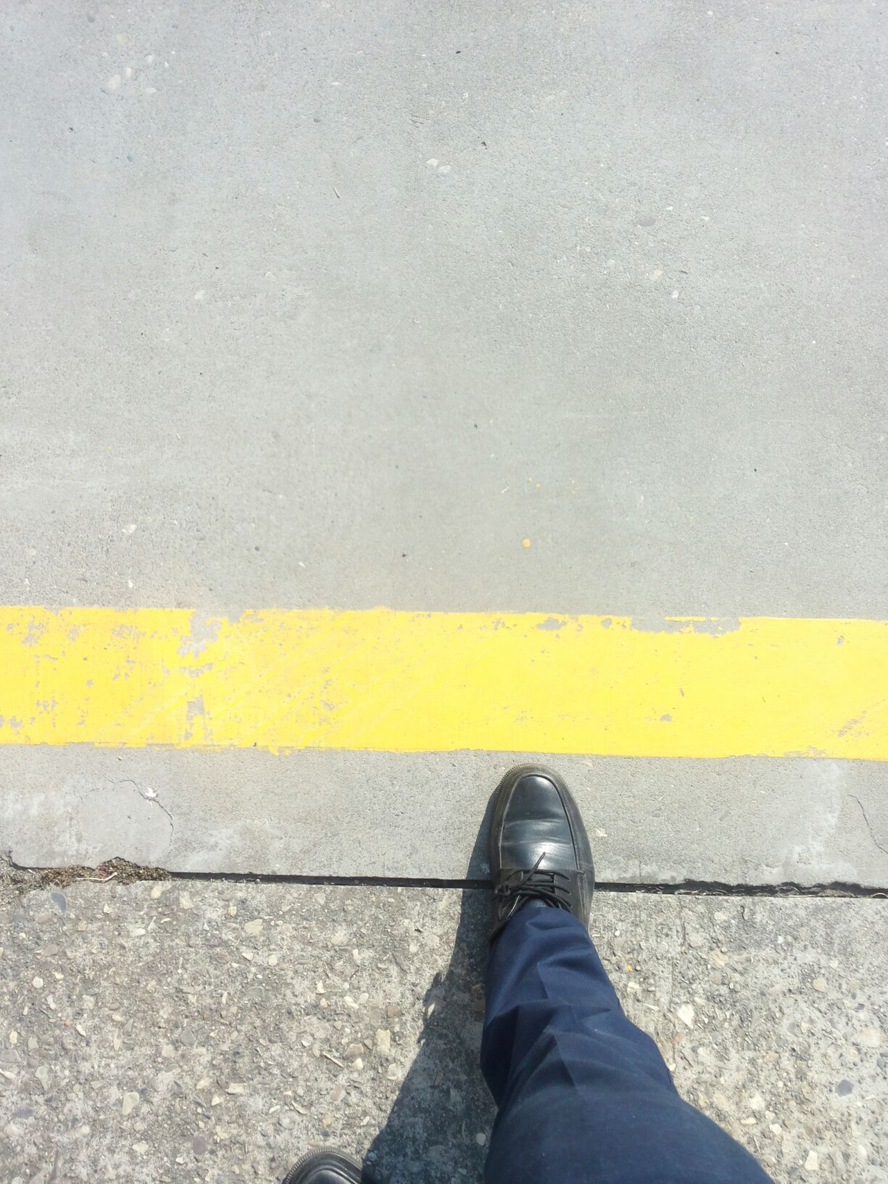 Do not cross the yellow line Low Section Shoe Human Leg Yellow One Person Human Body Part Standing Real People Personal Perspective Unrecognizable Person Men Road Lifestyles Day Outdoors Leisure Activity One Man Only Close-up People Adult Samsungphotography Shaping The Future. Together. Adapted To The City The Next Step Yellow Line
