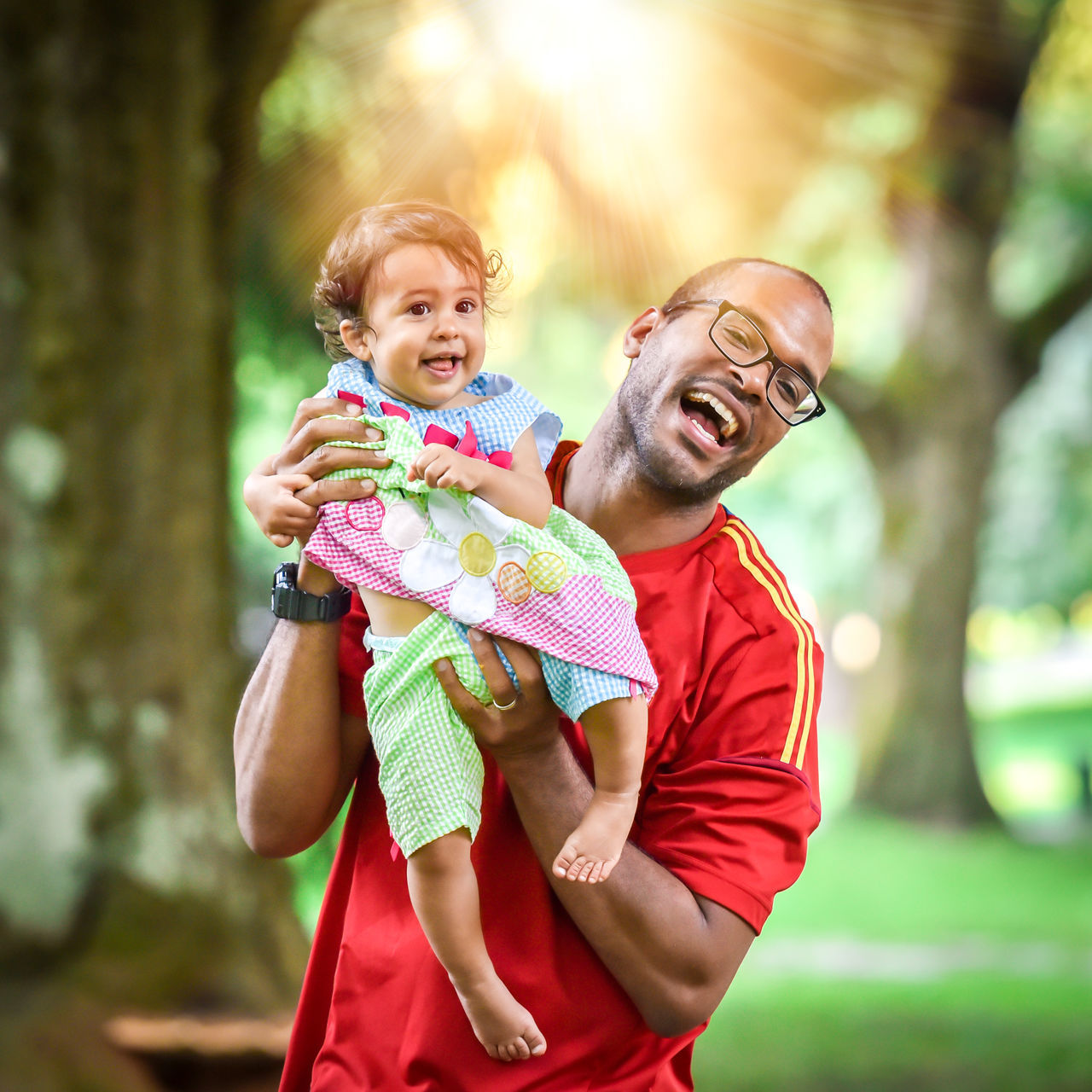 Adoption Baby Cheerful Daughter Enjoyment Family Family Family With One Child Father Females Fun Green Happiness Joy Lifestyles Love Males  Nature Parent Single Single Parent Smiling Son Togetherness Trees