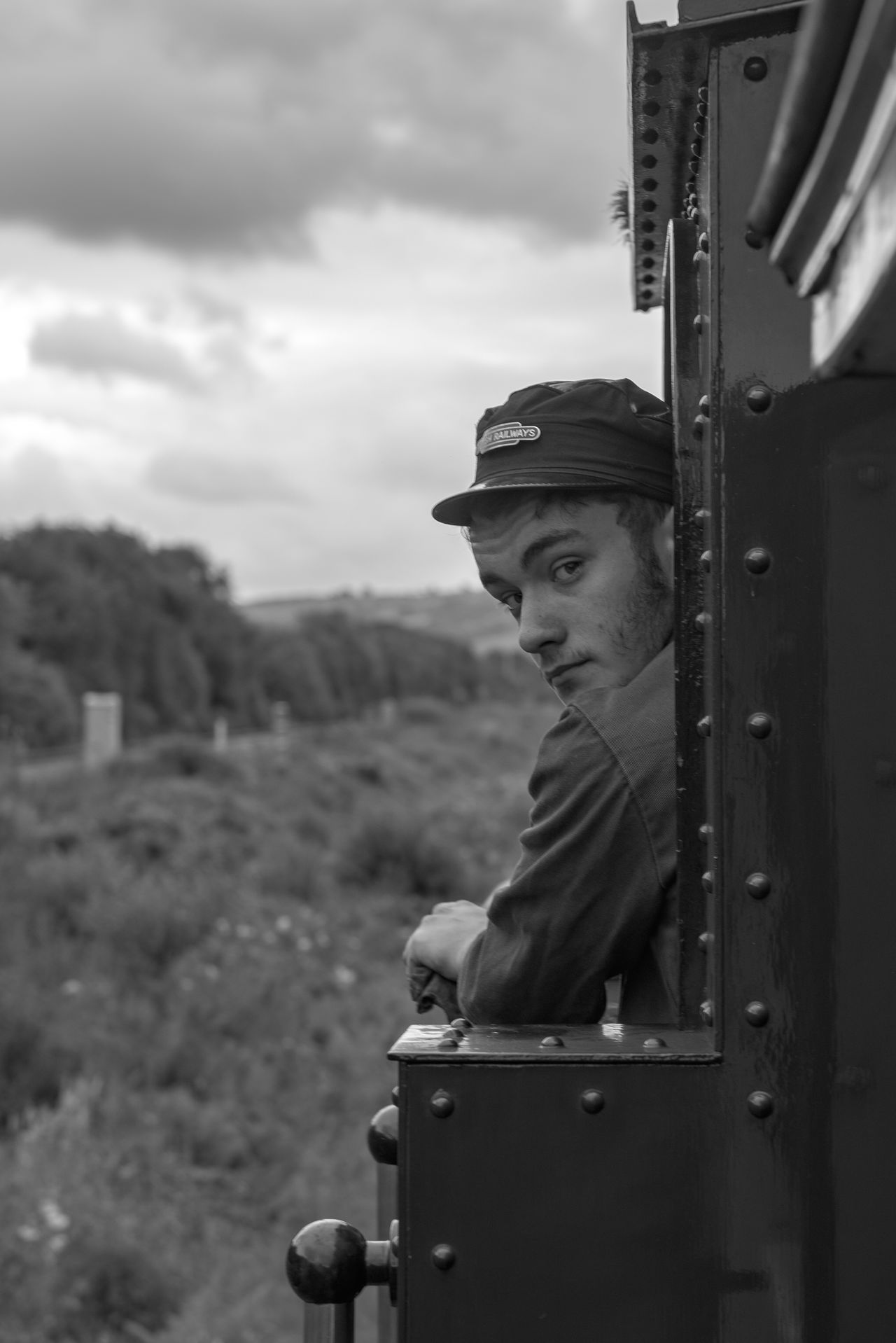Black And White Britain Close-up Driver Focus On Foreground Full Frame Looking At Camera Man Outdoors Person Portrait Selective Focus Steam Locomotive Monochrome_Photography Train Vintage Wales Www.benjaminvanderspek.com The Following We had no choice but to follow this man. He was driving the locomotive pulling our coaches. Need For Speed Feel The Journey On The Way Adventure Club Let's Go. Together.