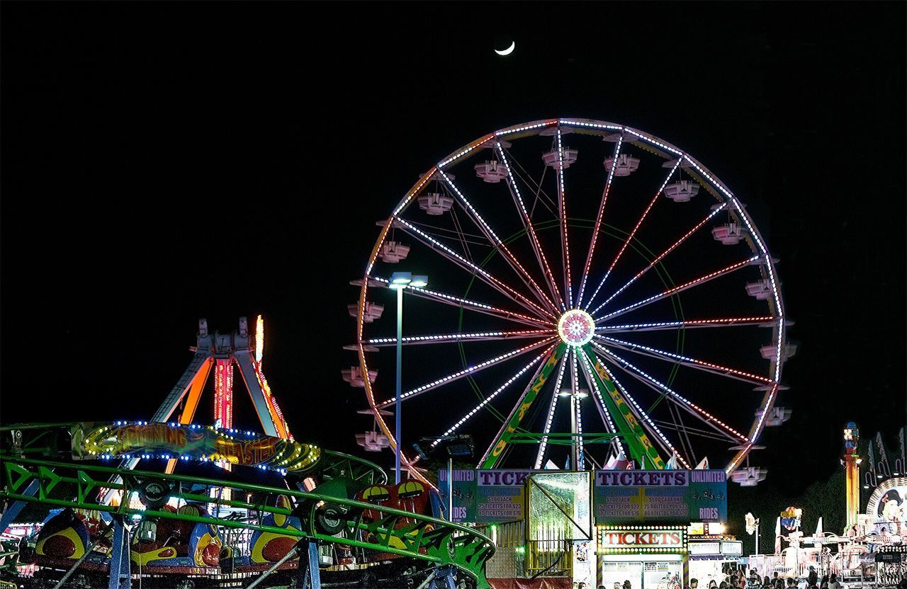 Neon Lights Ferris Wheel Night Amusement Park Ride Multi Colored Amusement Park Big Wheel Outdoors Illuminated Moon