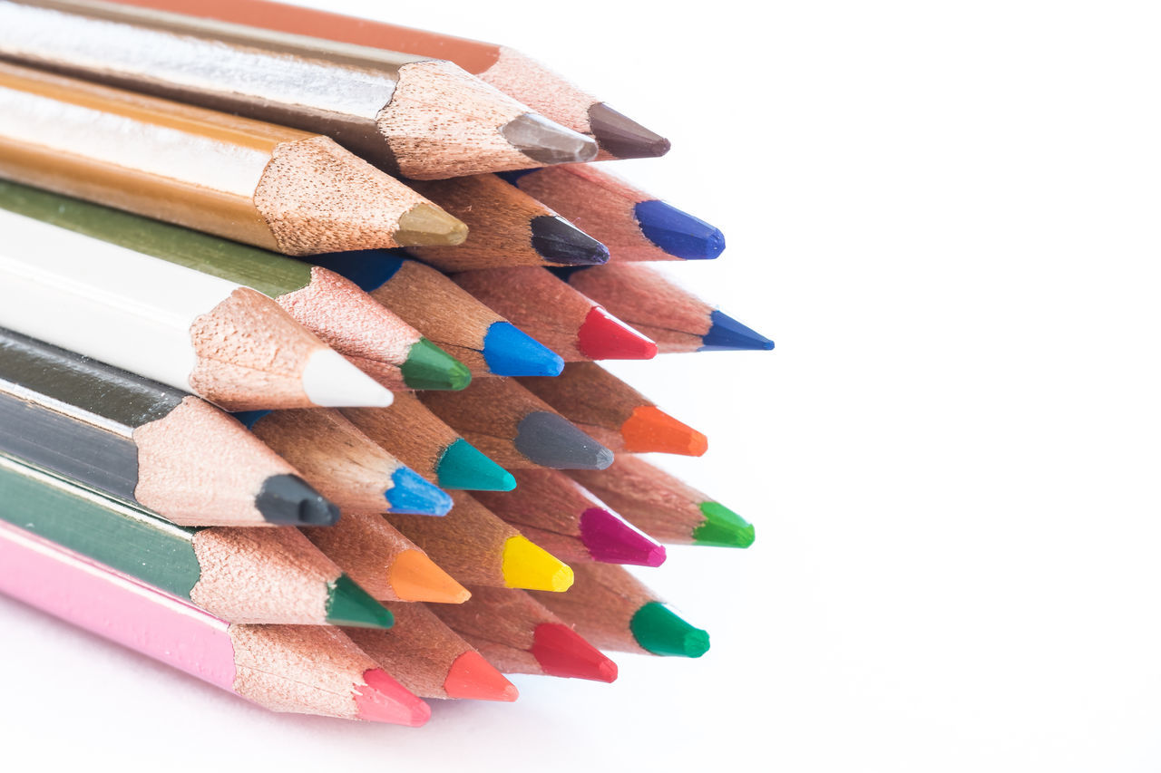 colored crayons on white background Brown Choice Close-up Colored Pencil Day Large Group Of Objects Multi Colored No People Still Life Studio Shot Variation Variety White Background Wood - Material