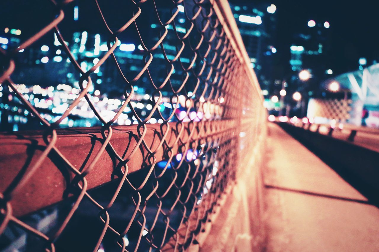 Close-Up Of Chainlink Fence On Bridge