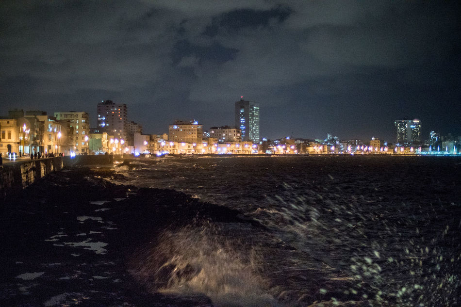 Even in the night the Ocean does it's duty and produces the waves the tourists like Architecture Beach City Cityscape Cuba Cuba Collection Day Havana Illuminated Malecon Night No People Outdoors Sky Skyscraper Splashing Waves Tourism Travel Travel Destinations Travelling Photography Urban Skyline Vacations Water
