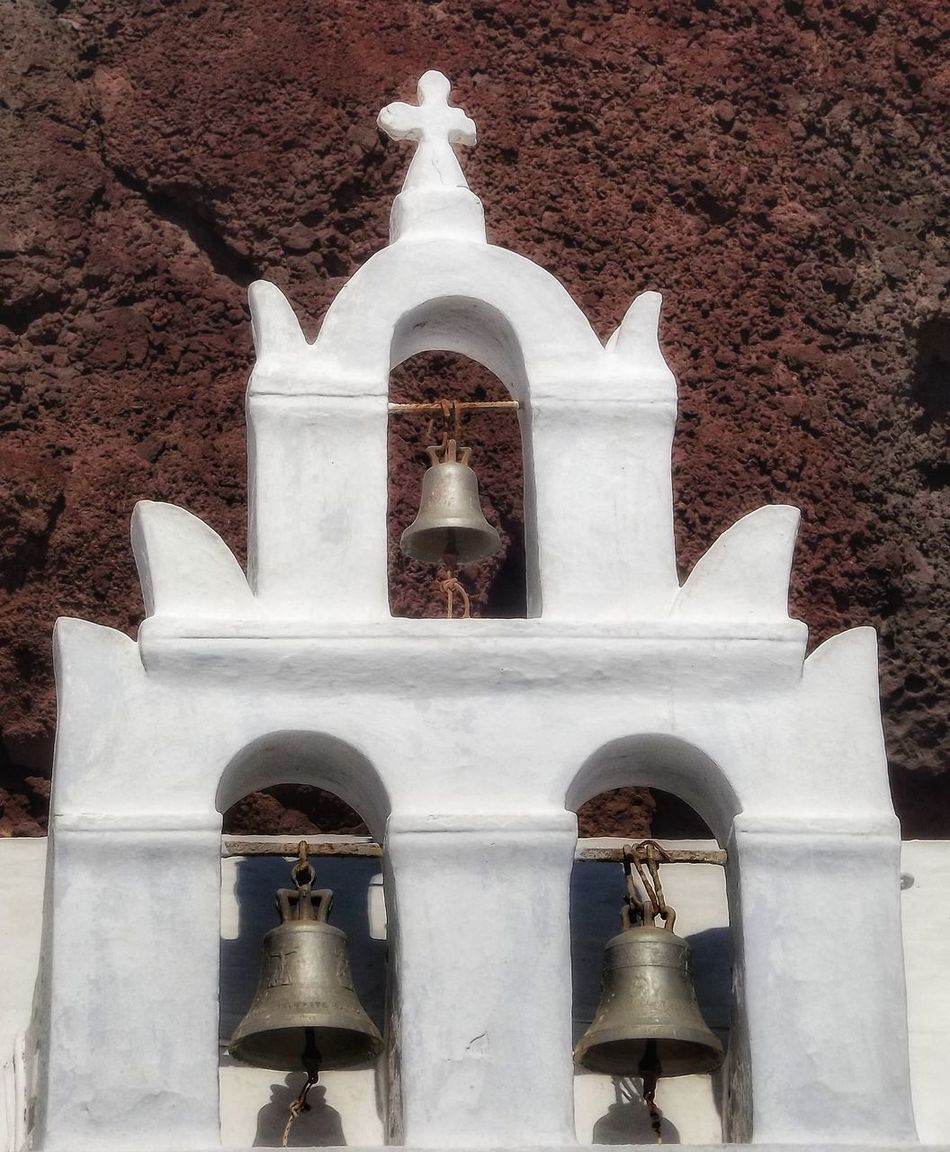 These greek church bells are on red beach Santorini Greece Architecture Built Structure Historic Building Exterior No People History Portrait_shots Creative Light And Shadow Color Photography Malephotographerofthemonth EyeEm Masterclass Tourism Greek Beauty Landscape_photography Architecture Coastal Beauty Tranquil Scene Coastline Greek Church Bell Tower - Tower Santorini Church Santorini, Greece Santorini