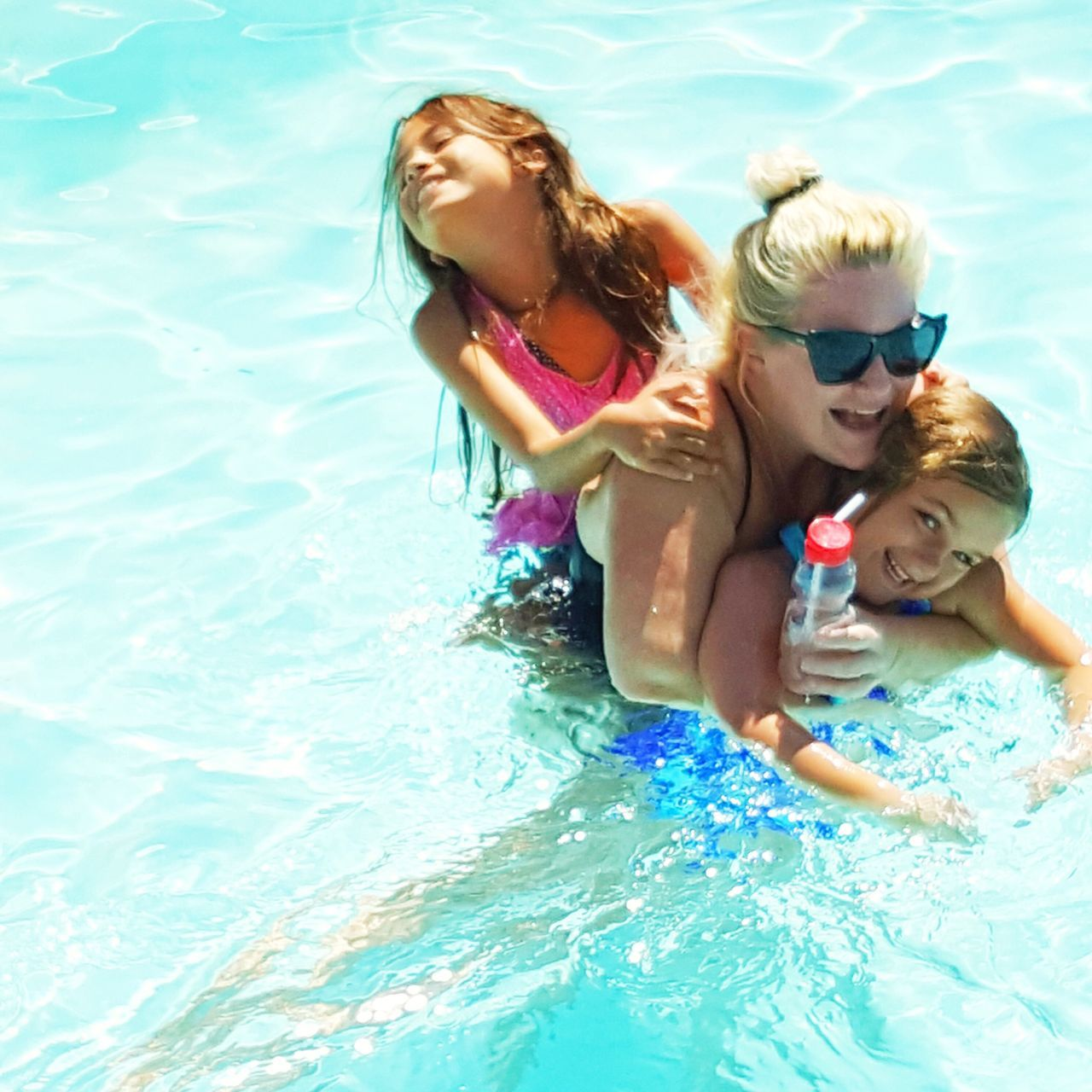 swimming pool, girls, childhood, togetherness, child, water, mother, leisure activity, boys, fun, summer, elementary age, daughter, day, family, bonding, enjoyment, vacations, happiness, smiling, outdoors, swimming, real people, friendship, people, adult
