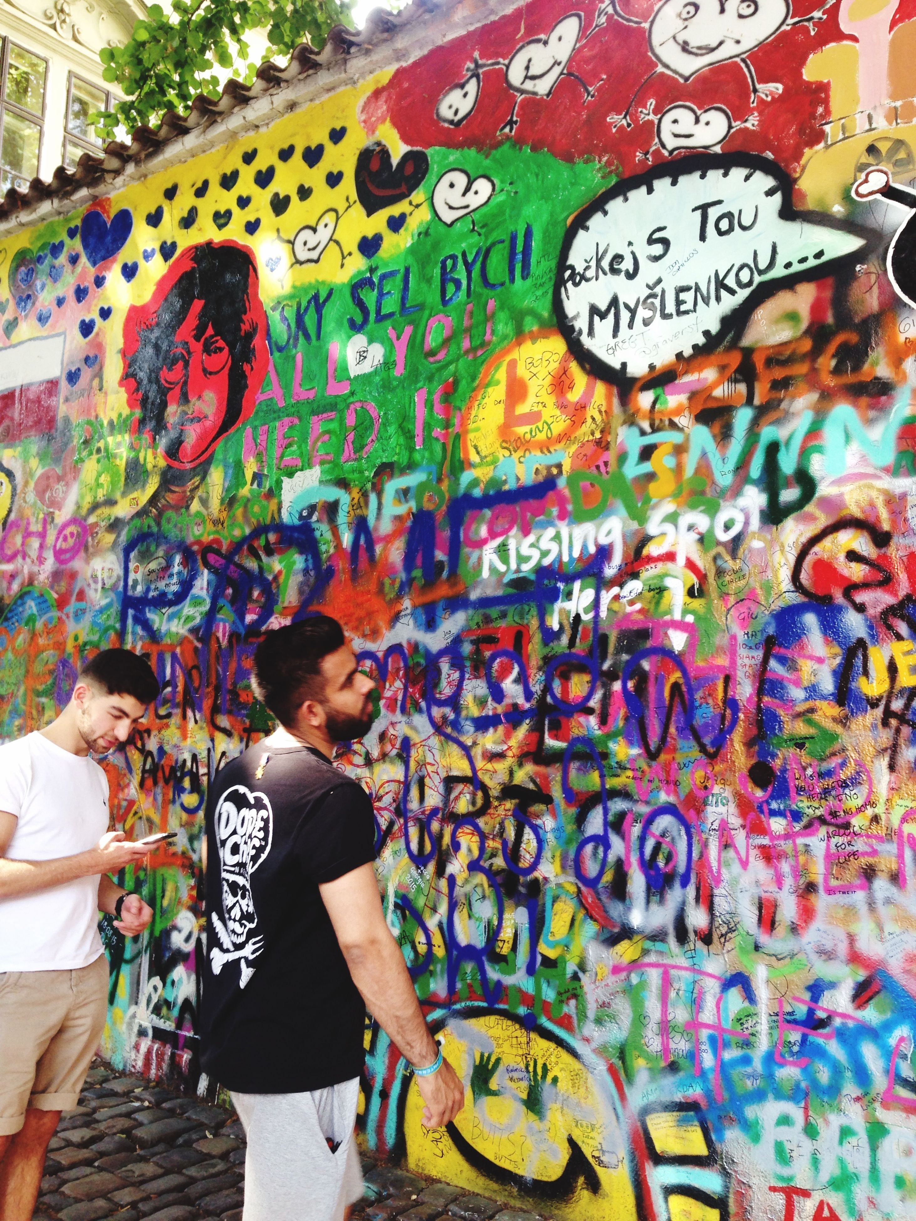graffiti, art, wall - building feature, creativity, multi colored, art and craft, lifestyles, casual clothing, leisure activity, standing, wall, text, painting, indoors, built structure, architecture, street art, front view