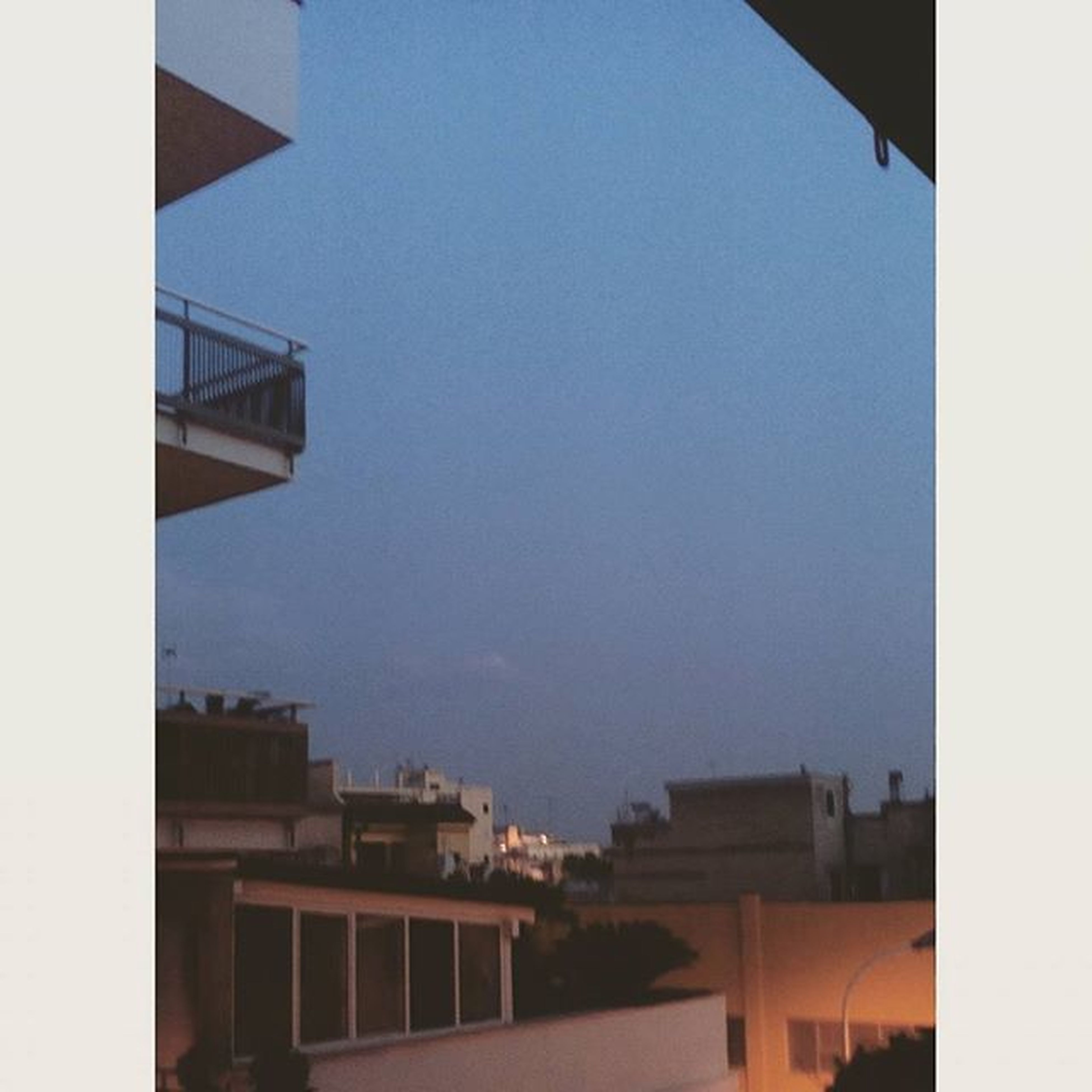 architecture, building exterior, built structure, transfer print, clear sky, auto post production filter, copy space, city, building, low angle view, residential structure, residential building, sky, house, outdoors, no people, day, blue, city life, window