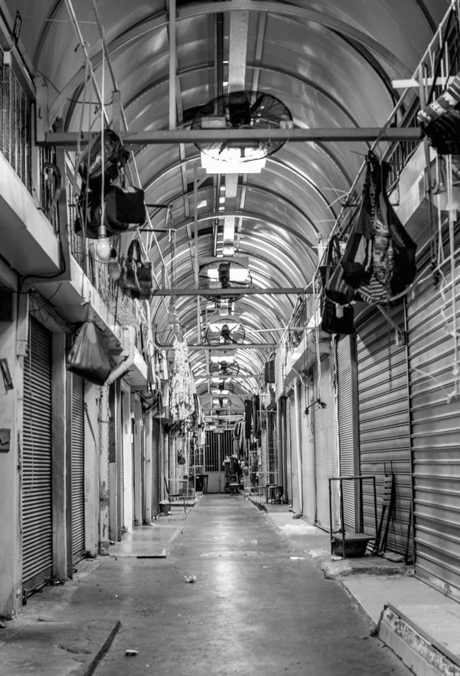 Jaffa FleeMarket By Night Architecture Black And White Blackandwhite Ceiling Ceiling Light  Closed Corridor Day Diminishing Perspective Emptiness Empty Empty Places Fleemarket In A Row Indoors  Market Narrow Night Nightphotography Overnight Success Shop Surface Level The Way Forward Monochrome Photography