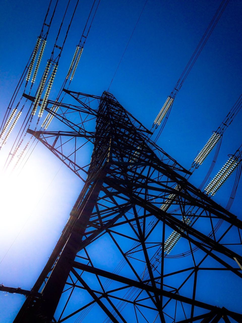 cable, connection, low angle view, electricity pylon, blue, electricity, no people, power line, power supply, clear sky, sky, technology, day, fuel and power generation, built structure, outdoors, architecture, sunlight