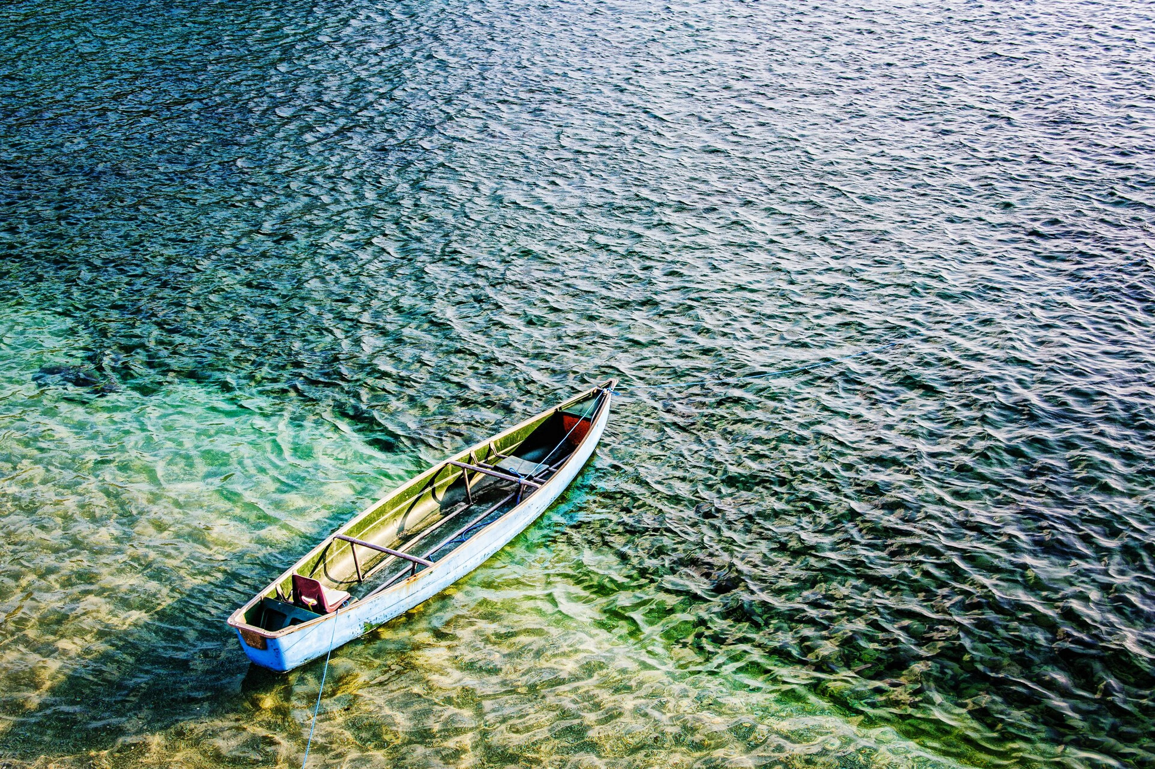 water, transportation, nautical vessel, mode of transport, boat, high angle view, nature, tranquility, rippled, lake, day, beauty in nature, moored, travel, tranquil scene, outdoors, river, sea, sailing, waterfront