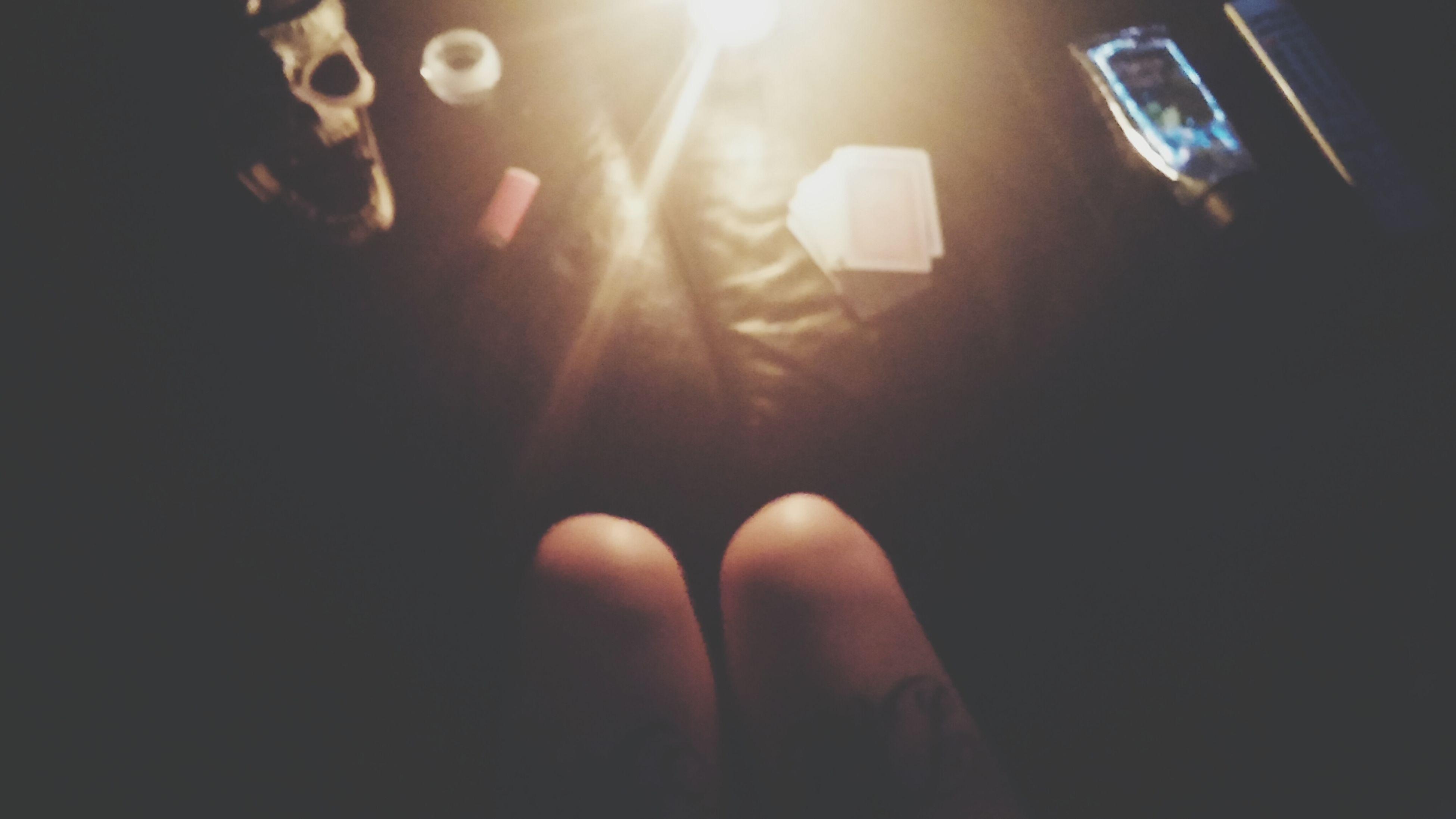 indoors, lifestyles, illuminated, leisure activity, night, lens flare, men, unrecognizable person, person, personal perspective, light - natural phenomenon, dark, sunlight, part of, sunbeam, glowing