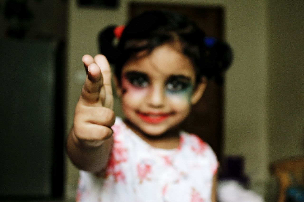 Looking At Camera Child Portrait One Girl Only People Childhood One Person Girls Human Body Part Front View Indoors  Smiling Human Hand Children Only Human Face Happiness Day Close-up Harley Quinn Cosplay Harley Quinn Harleygirl EyeEmNewHere The Portraitist - 2017 EyeEm Awards