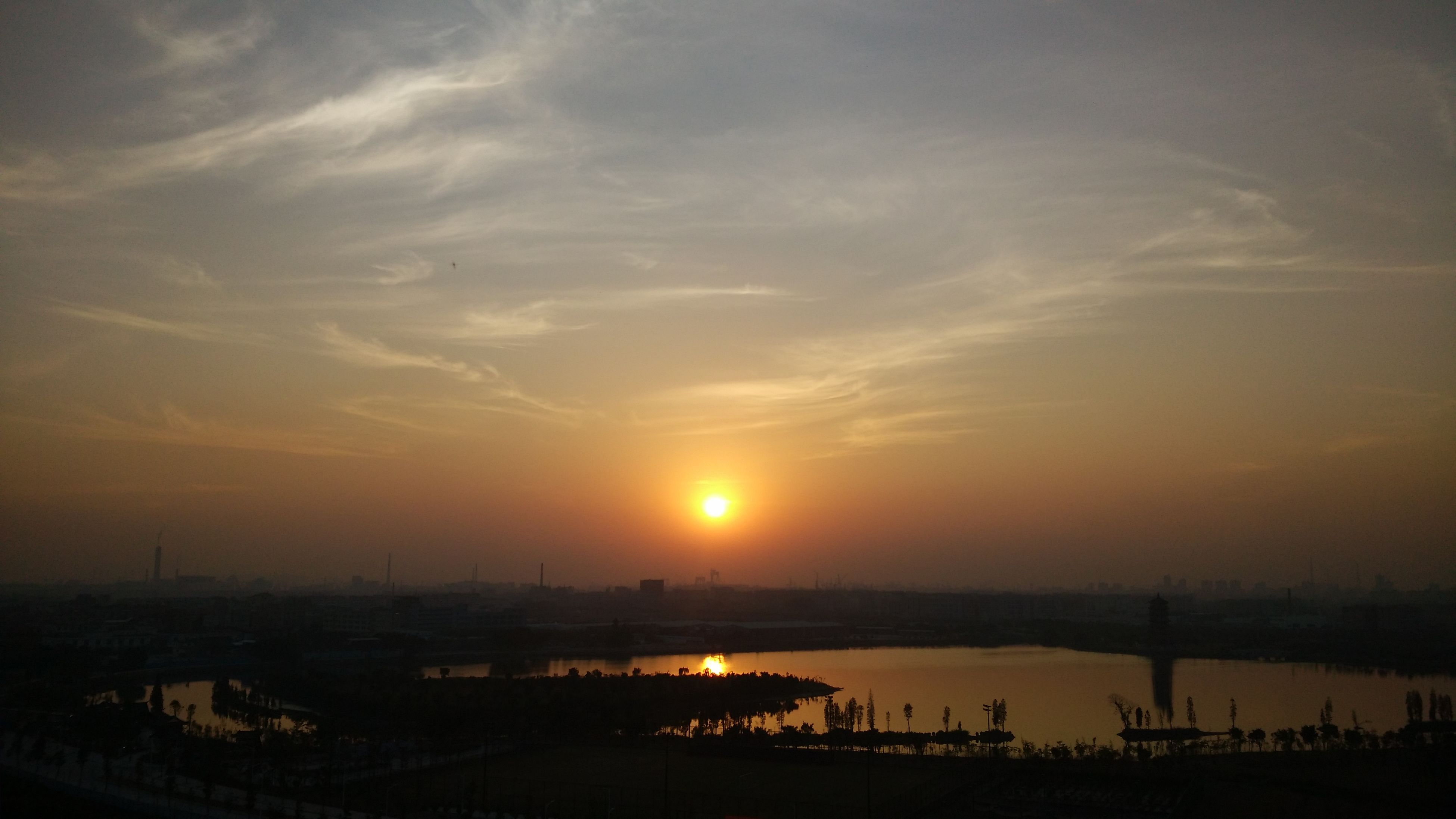 sunset, silhouette, sun, water, sky, orange color, scenics, built structure, cloud - sky, sea, architecture, beauty in nature, nature, tranquility, tranquil scene, connection, river, idyllic, sunlight, outdoors