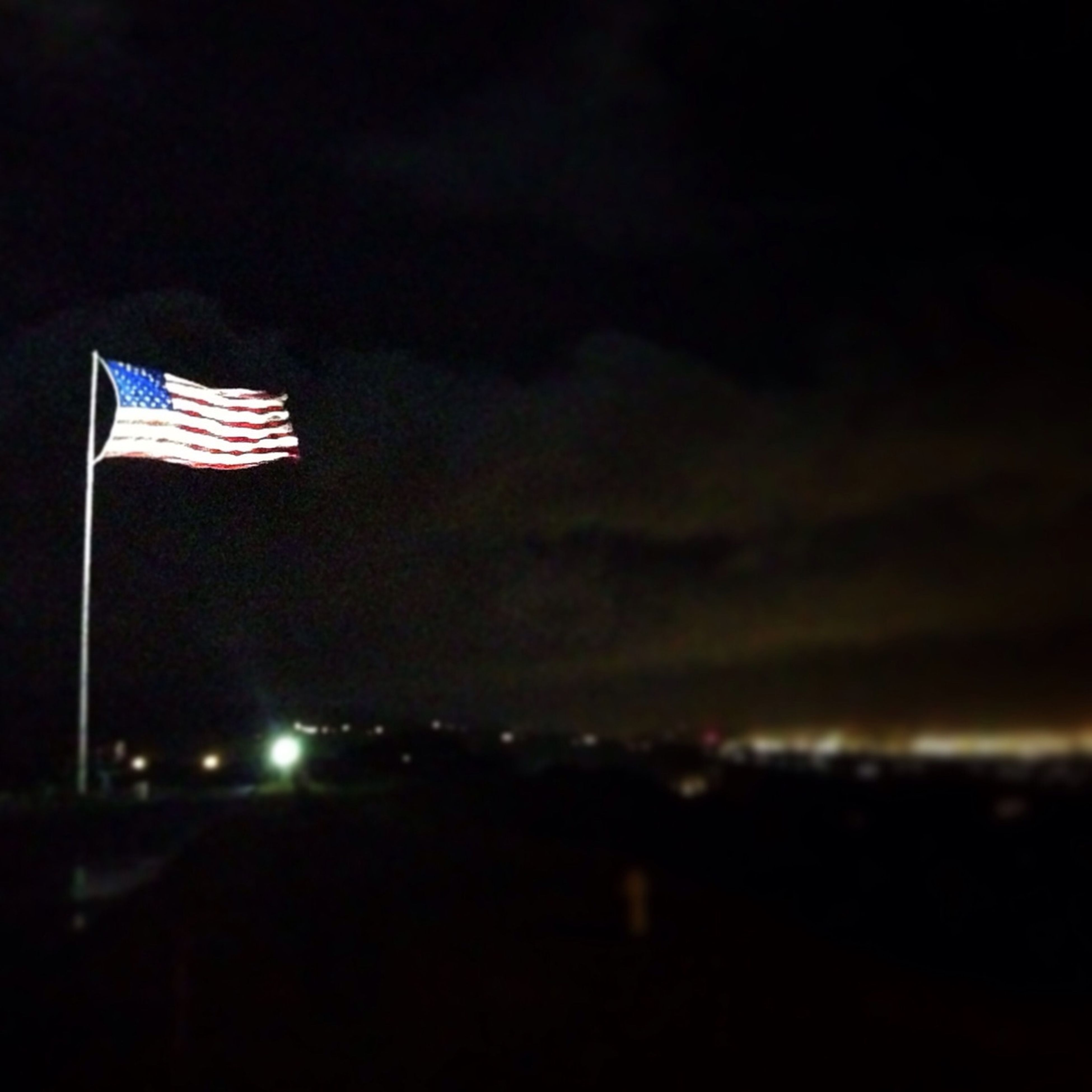 sky, flag, patriotism, identity, night, outdoors, cloud - sky, dusk, copy space, american flag, no people, red, low angle view, illuminated, cloud, nature, striped, building exterior, national flag, tranquility