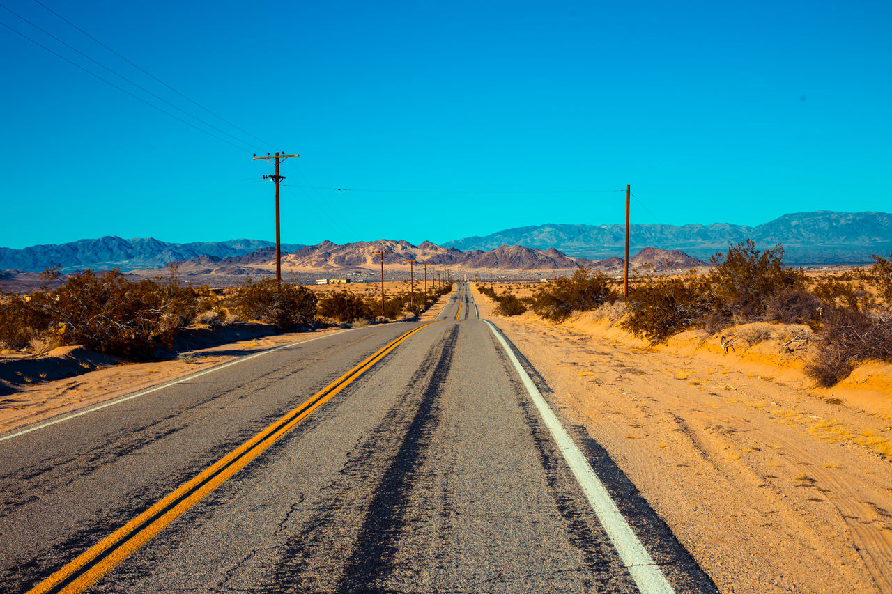 Americana, memories of a road trip Americana Country Road Mountain Range No People Outdoors Road Marking Sky Tranquil Scene Vanishing Point
