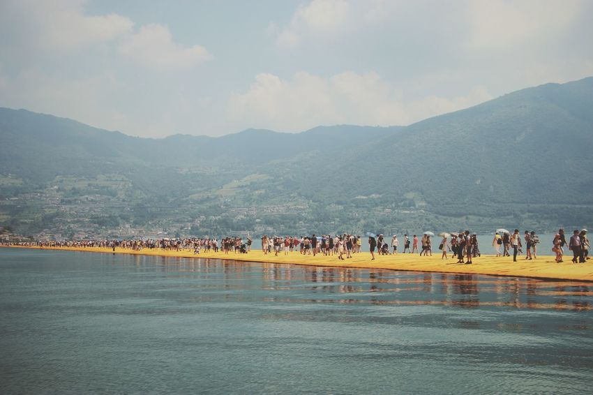Walking on the Floating piers   Golden Moments  Lake Walking Christo And The Floating Piers Sunshine The Essence Of Summer Getting Inspired Point Of View Still Life People Fine Art Edge Of Imagination Original Experiences 43 Golden Moments Showcase July The Floating Piers Lago D'Iseo EyeEm Italy  