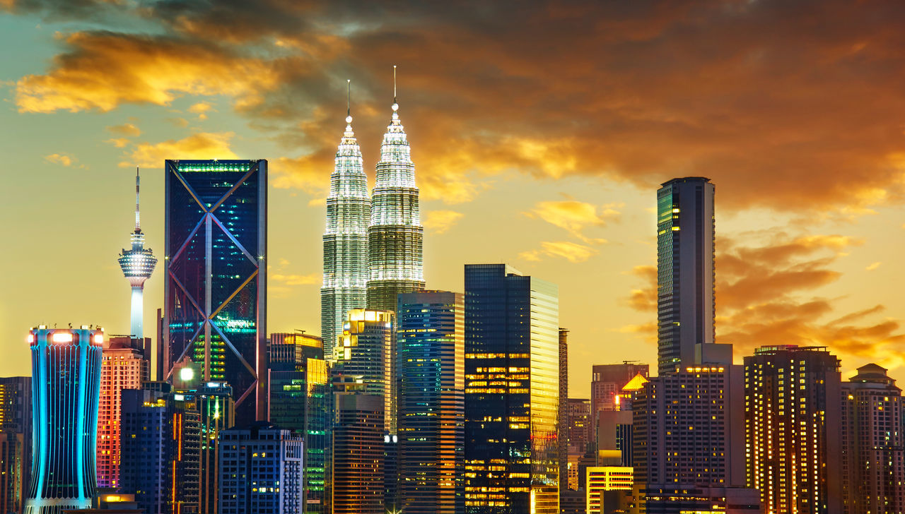 Dramatic scenery of the Kuala Lumpur city at sunset Architecture Building Exterior Business City City Life Cityscape Corporate Business Day Downtown District Finance Financial District  Growth Modern No People Outdoors Sky Skyscraper Sunset Tower Travel Destinations Urban Skyline