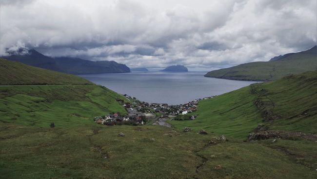 View to the little village kikvik on the faroe islands. Cliffs Clouds Day Faroe Islands Field Grass Island Islands Kikvik Landscape Landscapes Mountain View No People Ocean Outdoors Road Sea Shaped Steep Steeple Travel Travel Photography Valley View Waves