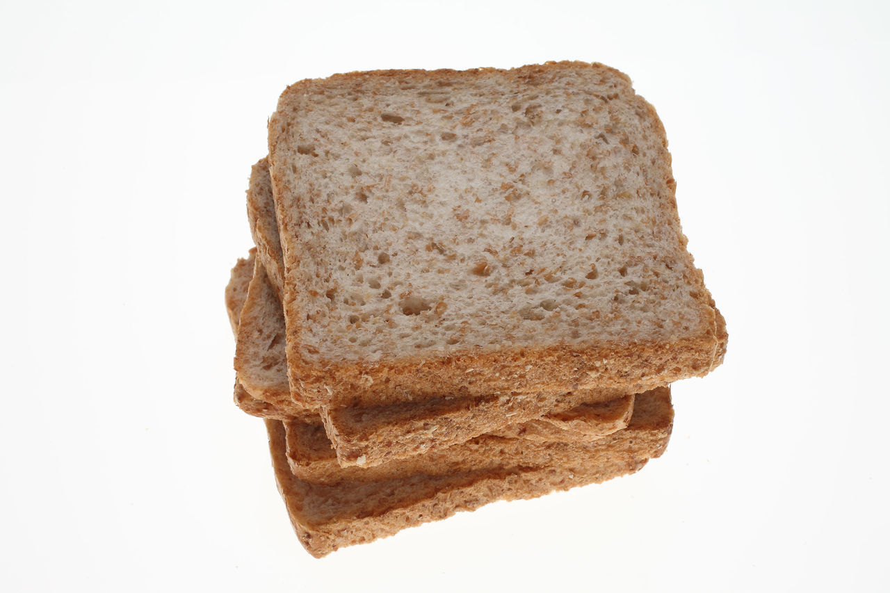 slices of Wholemeal toast bread on white Bread Close-up Geometric Shape Indulgence No People Slices Studio Shot Toastbread Toast🍞 White Background Wholemeal Wholemeal Bread