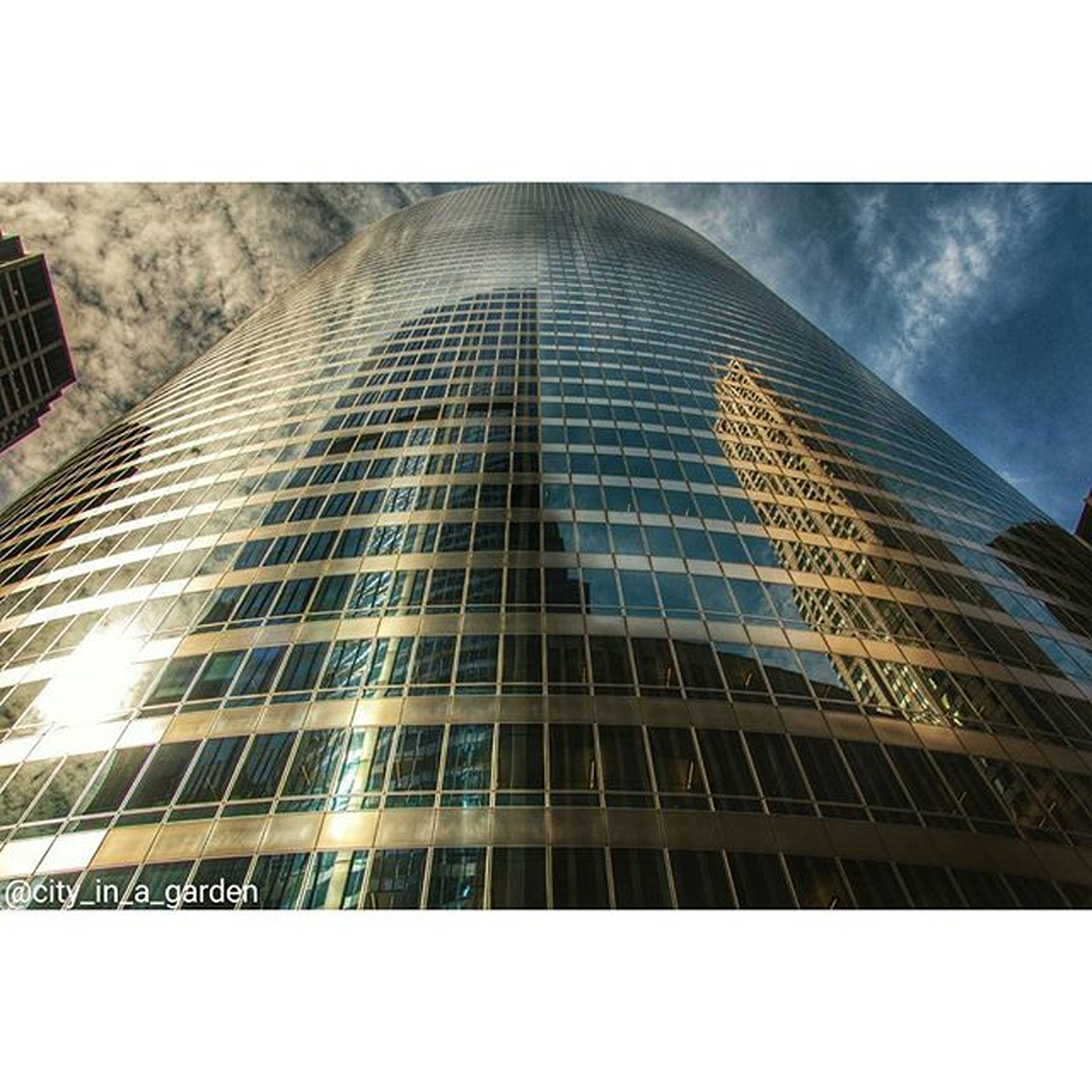 architecture, built structure, low angle view, building exterior, transfer print, modern, office building, skyscraper, auto post production filter, city, tall - high, tower, glass - material, sky, building, tall, window, reflection, day, outdoors