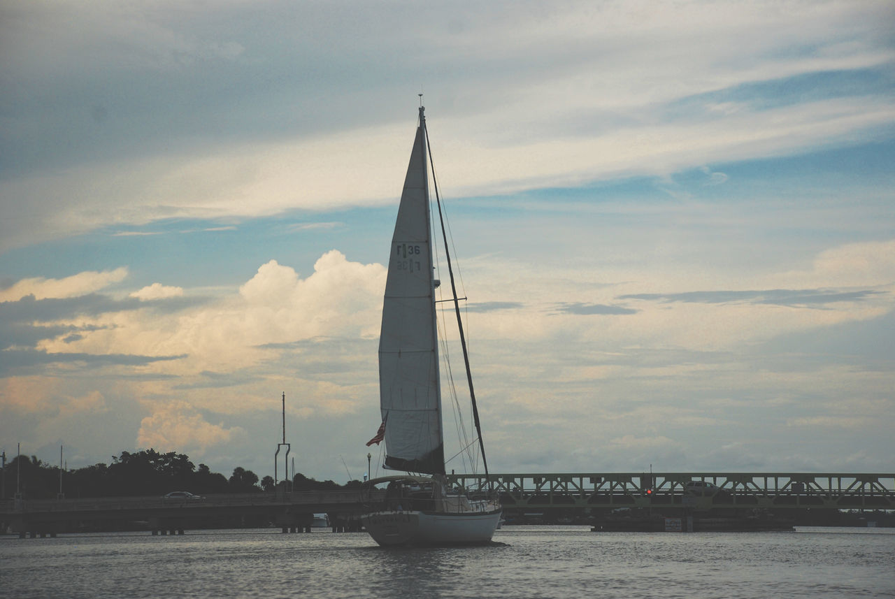 A sailboat standing by, awaiting passengers. Boats⛵️ Coast Day Lone Mast Nautical Vessel No People Ocean Outdoors Sailboat Sailing Sea Sky Sunset Water