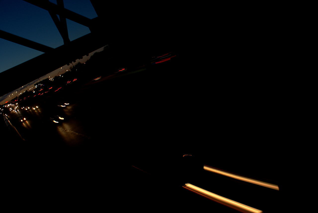 Evening drive home, car lights blur on the dark highway. Black Background Blue Hour Blue Sky Blurred Lights Car Lights Cars Commuting Dark Driving Driving Home Dusk In The City End Of Working Day Illuminated Lights In The Dark Motion Blur Night No People Silhouette Streak Of Light Structure Transportation